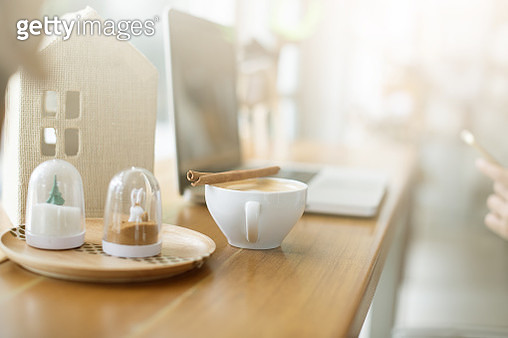 female hand holding japanese green tea (Matcha) on wooden table after working finish - gettyimageskorea