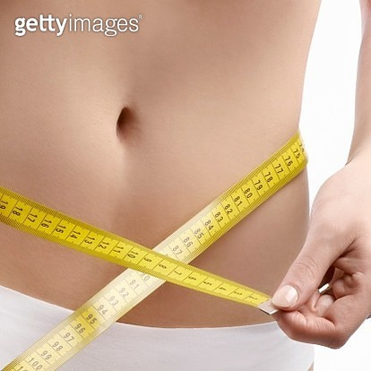 Woman measuring waist - gettyimageskorea