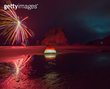 Camping on a Beach with 4th of July Fireworks Exploding at Night - gettyimageskorea