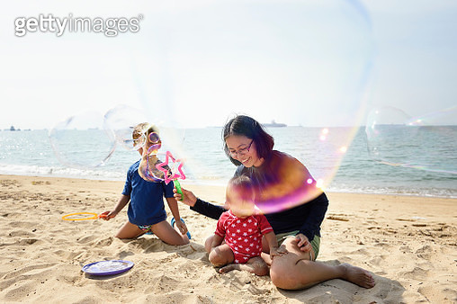 Singaporean family with young children at Singapore's East Coast Park - gettyimageskorea
