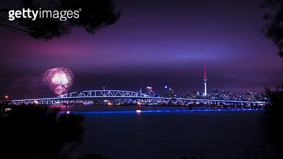 Dusk over Auckland Harbour Bridge with fireworks and Sunset over the Auckland Anniversary weekend - gettyimageskorea