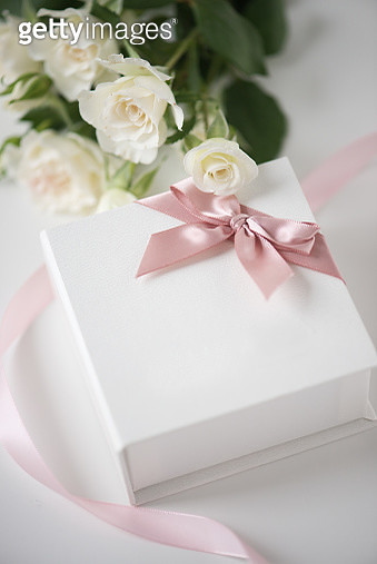 St. Valentine's white roses and present with a pink ribbon - gettyimageskorea