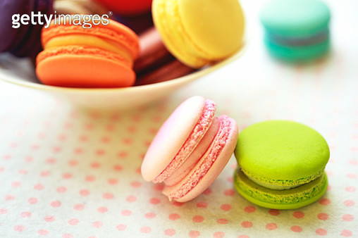 Sweet and colourful french macaroons on retro-vintage macaroons background - gettyimageskorea