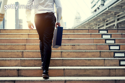 Monday morning of work Businessman walking up the stairs in a rush hour to work. Hurry time. working man - gettyimageskorea