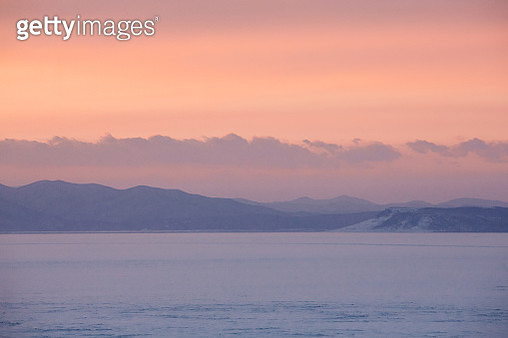 Amur bay in winter with sea ice and sunset in Vladivostok, Siberia, Russia 2018 - gettyimageskorea