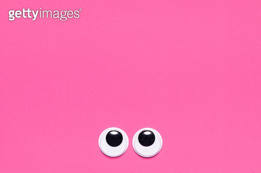 Googly Eyes Looking Up on Colored Background, Anthropomorphic Face. - gettyimageskorea