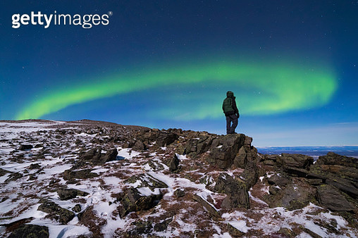 'A man watches the aurora borealis from high on Donnelly Dome, south of Delta Junction.' - gettyimageskorea