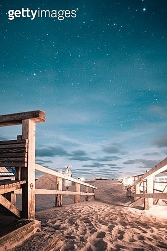 Scenic View Of Beach Against Sky At Night - gettyimageskorea