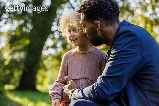 Father and young daughter in park area - gettyimageskorea