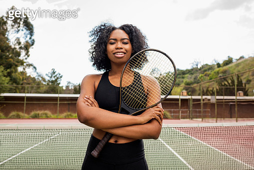 Young woman on tennis court - gettyimageskorea