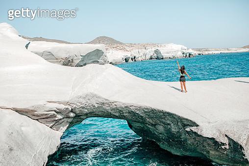 young female tourist exploring SARAKINIKO beach,MILOS,GREECE - gettyimageskorea