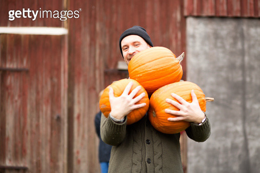 Man carrying pumpkins - gettyimageskorea