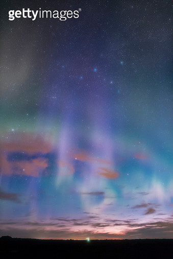 Constellation Cassiopeia and aurora borealis, the northern lights, in morning twilight. - gettyimageskorea