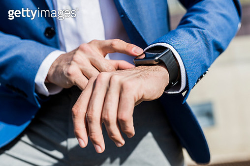 Close-up of businessman with smartwatch - gettyimageskorea