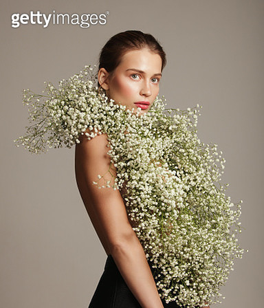 Beautiful woman with flower bouquet - gettyimageskorea