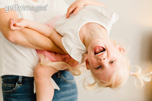 Portrait of happy little girl playing with her mother - gettyimageskorea
