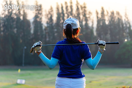 Women golfer Using golf clubs To help twist To warm up body before the play game, with blurred soft nature background,Lifestyle Concept. Sport Concept - gettyimageskorea