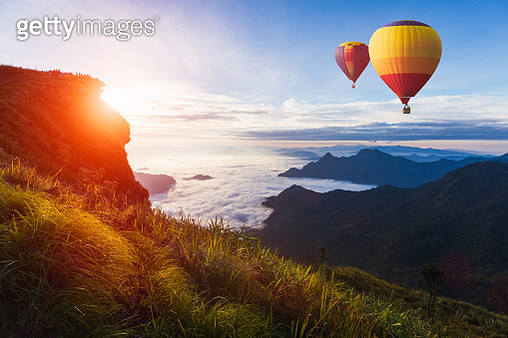 Colorful hot-air balloon flying over the mountain - gettyimageskorea