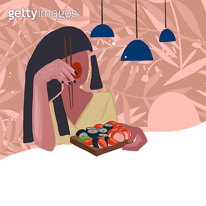 Girl with ruby chicks eating sushi in the restaurant. Floral background. - gettyimageskorea