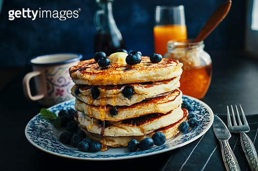 Stack of Pancakes with Maple Syrup and Fresh Blueberries - gettyimageskorea