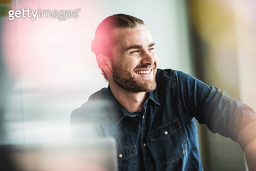 Portrait of smiling young businessman in office - gettyimageskorea