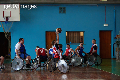 Disabled sportsmen playing basketball - gettyimageskorea