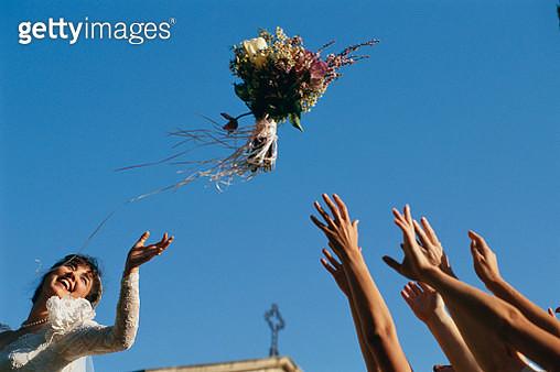 Bride Throwing Bouquet - gettyimageskorea