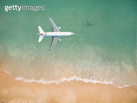Airplane flying over the beach - gettyimageskorea