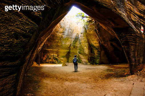 A young woman solo traveler at Naida Caves, Diu, India. - gettyimageskorea
