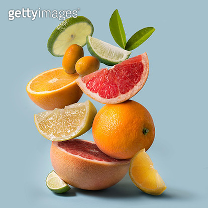 Assorted citrus fruits still life on light blue background. Close up view. - gettyimageskorea