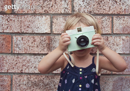 Young Girl Holding Toy Camera - gettyimageskorea
