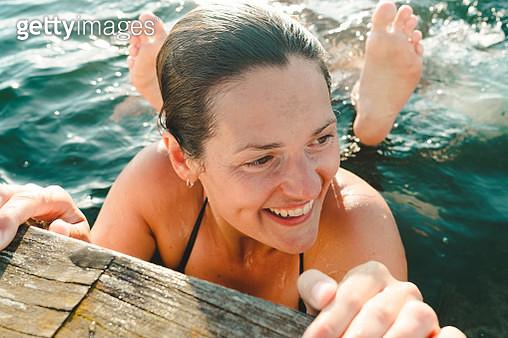 Happy woman in sea - gettyimageskorea