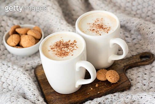 Cappucino or latte with cinnamon and cookies - gettyimageskorea
