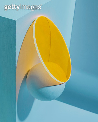 Teal and yellow monochrome geometric still life featuring translucent circle and round object - gettyimageskorea