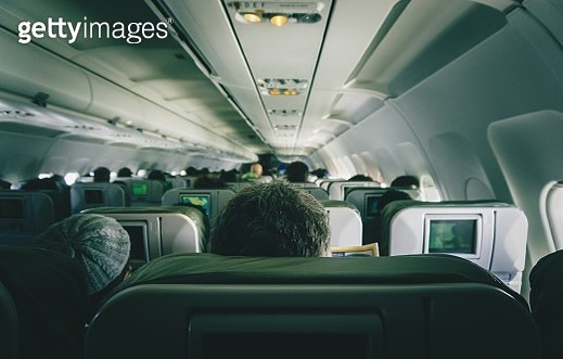 Rear View Of People Sitting In Airplane - gettyimageskorea