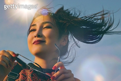 Low Angle View Of Woman Against Sky - gettyimageskorea