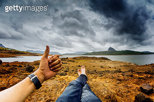 Thumbs up in personal perspective at Pawna Lake - gettyimageskorea