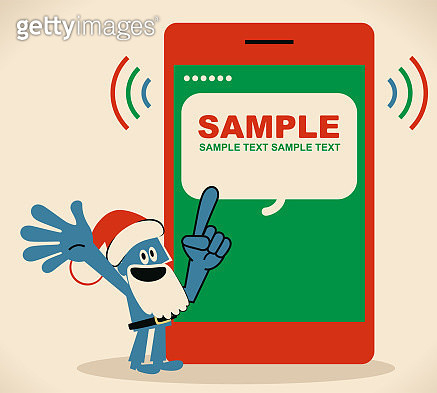 Blue man with santa hat and beard pointing at a mobile phone screen - gettyimageskorea
