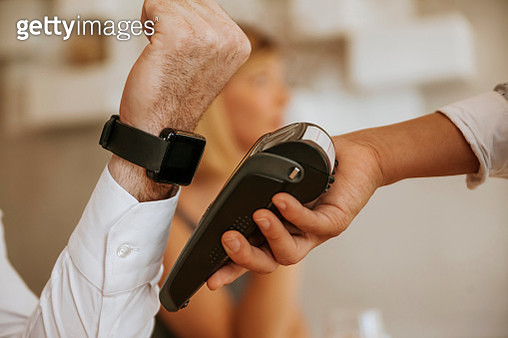 Contactless payment with smartwatch in cafe - gettyimageskorea