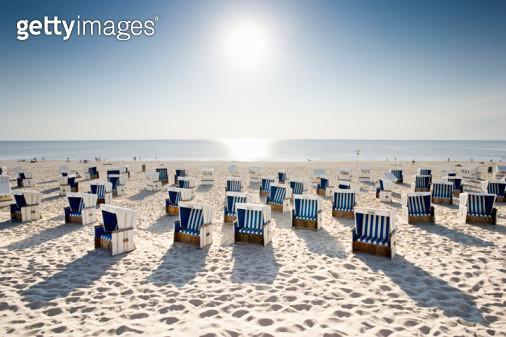 Wicker chairs on beach  - gettyimageskorea