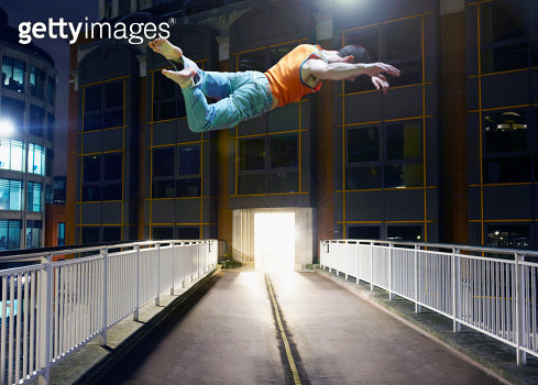 man jumping in city - gettyimageskorea