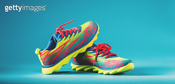 Colorful running sneakers on a blue background - gettyimageskorea