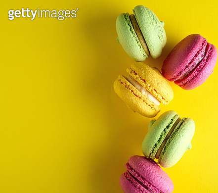 Directly Above Shot Of Macaroons On Yellow Background - gettyimageskorea