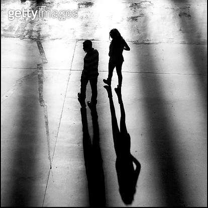 High Angle View Of Silhouette Man And Woman Walking On Street - gettyimageskorea