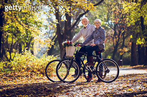 Senior couple riding bicycles - gettyimageskorea