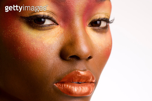 African American woman with colorful make up, close up on white. - gettyimageskorea