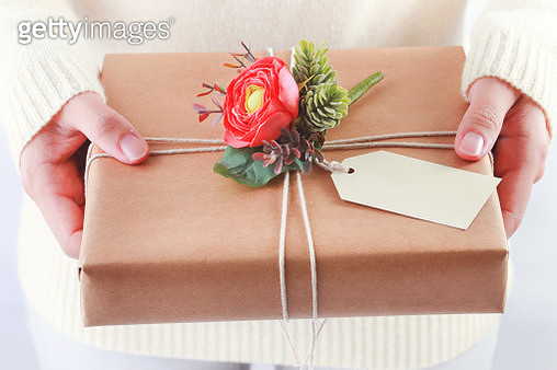 Close-Up Of Woman Holding Gift Box - gettyimageskorea