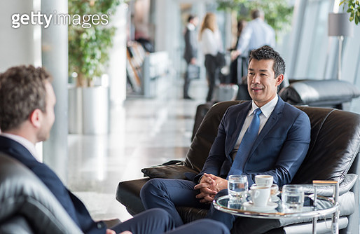Businessmen At Airport Waiting For A Flight - gettyimageskorea