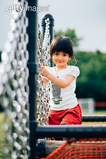 Cute mixed race girl smiling at playground - gettyimageskorea