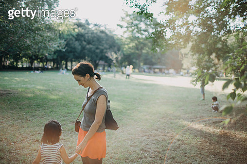 Mother and child holding hands at park - gettyimageskorea